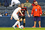 13 December 2015: Stanford's Jordan Morris (13) and Clemson's Kyle Fisher (left). The Clemson University Tigers played the Stanford University Cardinal at Sporting Park in Kansas City, Kansas in the 2015 NCAA Division I Men's College Cup championship match. Stanford won the game 4-0.