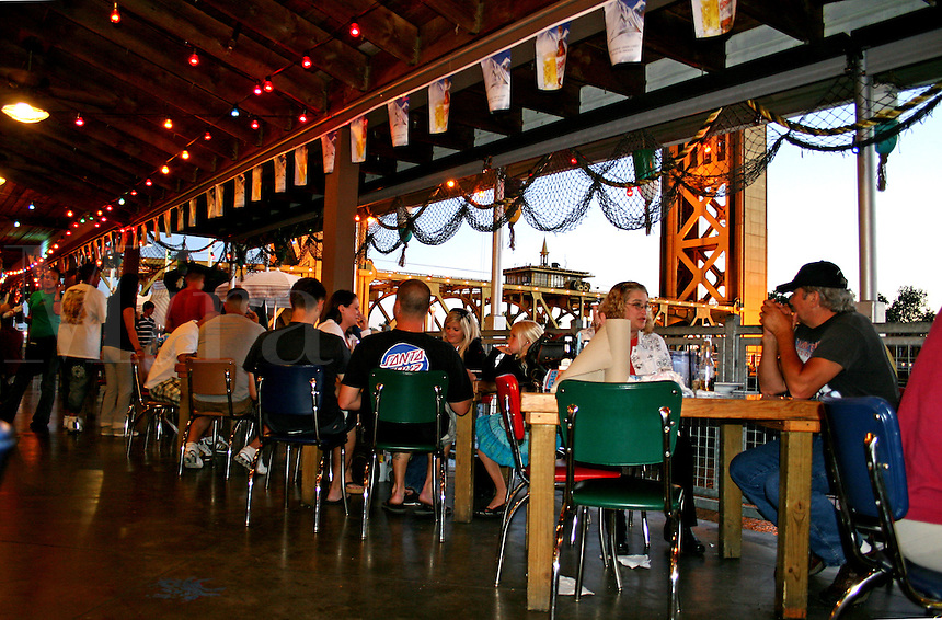People dining interior Joe's Crab Shack restaurant in Old Sacramento California