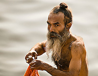 Man emerging from his daily dip in the Ganges.<br /> (Photo by Matt Considine - Images of Asia Collection)