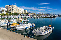 Estepona, Malaga Province, Spain, marina, December, 2018, 201812080111<br /><br />Copyright Image from Victor Patterson, 54 Dorchester Park, <br />Belfast, UK, BT9 6RJ<br /><br />t1: +44 28 9066 1296 (from Rep of Ireland 048 9066 1296)<br />t2: +44 28 9002 2446 (from Rep of Ireland 048 9002 2446)<br />m: +44 7802 353836<br /><br />victorpattersonbelfast@gmail.com<br /><br />Please see my Terms and Conditions of Use at victorpatterson.com. It is IMPORTANT that you familiarise yourself with them.<br /><br />Images used on the Internet incur an additional cost and must be visibly watermarked i.e. &copy; Victor Patterson within the body of the image and copyright metadata must not be deleted. Images used on the Internet have a size restriction of 4kbs and are chargeable at rates available at victorpatterson.com.<br /><br />This image is available only for the use of the download recipient i.e. television station, newspaper, magazine, book publisher, etc, and must not be passed on to any third party. It is also downloaded on condition that each and every usage is notified within 7 days to victorpattersonbelfast@gmail.com<br /><br />The right of Victor Patterson (or the named photographer) to be identified as the author is asserted in accordance with The Copyright Designs And Patents Act (1988). All moral rights are asserted.