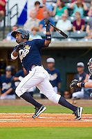 Eduardo Nunez #26 of the New York Yankees follows through on his swing while playing for the Charleston RiverDogs against the Rome Braves at Joseph P. Riley Park on July 2, 2013 in Charleston, South Carolina.  The RiverDogs defeated the Braves 4-2.   (Brian Westerholt/Four Seam Images)