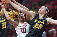 NWA Democrat-Gazette/J.T. WAMPLER Arkansas' Kiara Williams vies for a rebound with Missouri's Cierra Porter (21) and Jordan Frericks Monday Feb. 12, 2018 at Bud Walton Arena in Fayetteville.