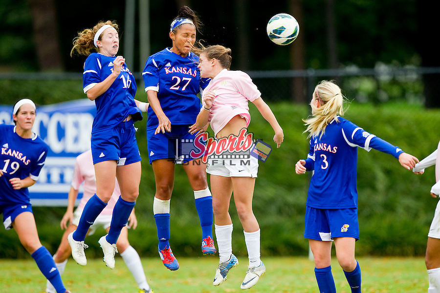 Cassie Dickerson (27) of the Kansas Jayhawks heads the ball away from Ally Berry (8) of the Wake Forest Demon Deacons at Spry Soccer Stadium on October 7, 2012 in Winston-Salem, North Carolina.  The Demon Deacons and the Jayhawks battled to a 1-1 tie in double overtime.  (Brian Westerholt/Sports On Film)