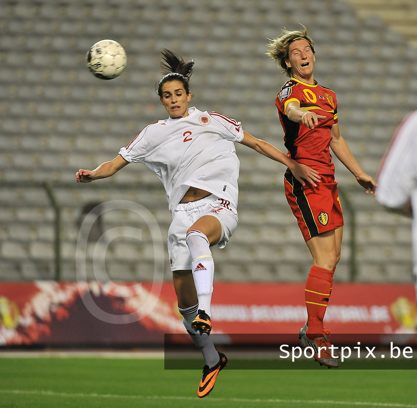 20130921 - BRUSSELS , BELGIUM : header pictured between Belgian Aline Zeler (10) and Albanian Robeli Arbnora during the female soccer match between Belgium and Albania , on the first matchday in group 5 of the UEFA qualifying round to the FIFA Women World Cup in Canada 2015 at the Koning Boudewijn Stadion , Brussels . Saturday 21th September 2013. PHOTO DAVID CATRY