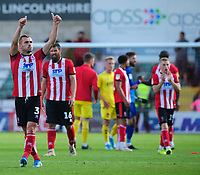 Lincoln City's Harry Toffolo acknowledges the fans at the end of the game<br /> <br /> Photographer Chris Vaughan/CameraSport<br /> <br /> The EFL Sky Bet League One - Lincoln City v Fleetwood Town - Saturday 31st August 2019 - Sincil Bank - Lincoln<br /> <br /> World Copyright © 2019 CameraSport. All rights reserved. 43 Linden Ave. Countesthorpe. Leicester. England. LE8 5PG - Tel: +44 (0) 116 277 4147 - admin@camerasport.com - www.camerasport.com