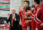 WOLCOTT, CT-031418JS05- Wamogo head coach Gregg Hunt and other platers, applauds a play during their Division V semifinal game against East Hampton Wednesday at Wolcott High School. <br /> Jim Shannon Republican-American