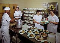 Man serving food in the nursing home.