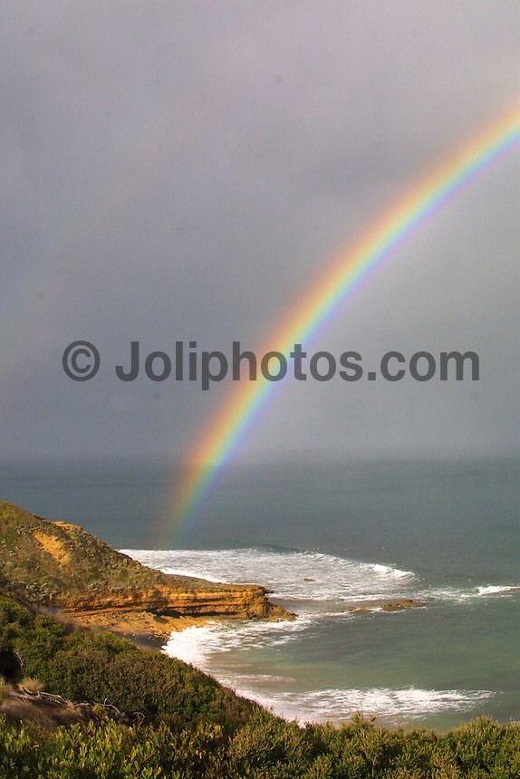 A rainbow over the Winki section of the Bells Beach surfing reserve, Torquay , Victoria, Australia.. Photo Joliphotos.com