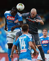 19th July 2020; Stadio San Paolo, Naples, Campania, Italy; Serie A Football, Napoli versus Udinese; Kalidou Koulibaly of Napoli  challenges Bram Nuytinck of Udinese Calcio for the header