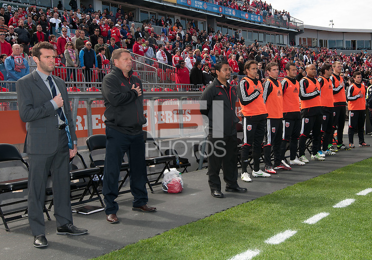 05 May 2012: D.C. United coach Ben Olsen with his training staff and substitute players stand during the national anthems in an MLS game between DC United and Toronto FC at BMO Field in Toronto..D.C. United won 2-0.