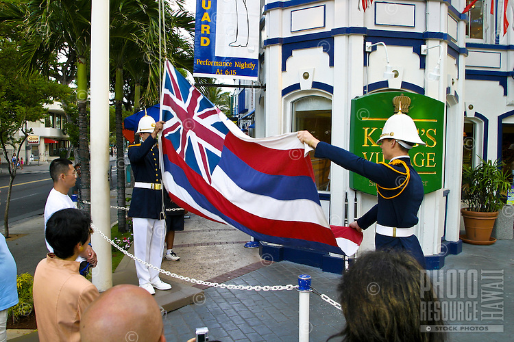 Dressed in full regalia, the Royal Guard performs its event each evening for tourists at the King's Village near Waikiki Beach, Oahu. Here they conclude the event with the folding of the Hawaii State Flag.