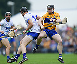 Kevin Moran of Waterford  in action against Tony Kelly of Clare during their Munster  championship round robin game at Cusack Park Photograph by John Kelly.