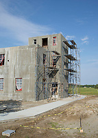 BNPS.co.uk (01202 558833)<br /> Pic: MilitaryAviationMuseum/BNPS<br /> <br /> Over There, Over There - The rebuilt control tower of RAF Goxhill has now been put back together again at the Military Aviation Muuseum in Virginia USA. <br /> <br /> A historic World War Two airfield control tower which helped protect Britain's skies has been transported 4,000 miles to a museum in the United States.<br /> <br /> The monument at RAF Goxhill in North Lincolnshire was dismantled brick by brick before the materials were shipped across the Atlantic to the Military Aviation Museum in Pungo, Virginia.<br /> <br /> The watchtower has been reassembled to look how it would have seven decades ago and is now open to visitors.<br /> <br /> Goxhill was the first airfield to be allocated to the Americans during the conflict, with General D. Eisenhower attending the handover ceremony in August 1942.<br /> <br /> The three year project to relocate the structure, which has cost about £75,000, was overseen by the museum's owner Jerry Yagen. When he heard the watchtower was languishing in a derelict state on the site of the former British airfield, he decided to save it to 'preserve its legacy'.