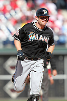 Miami Marlins outfielder Austin Kearns #26 rounds the bases after hitting a solo home run in the ninth inning during a game against the Philadelphia Phillies at Citizens Bank Park on April 9, 2012 in Philadelphia, Pennsylvania.  Miami defeated Philadelphia 6-2.  (Mike Janes/Four Seam Images)