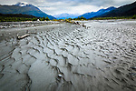 Mudflat at Lowe River. Mountain range in the background. Valdez, Southcentral Alaska, Autumn.