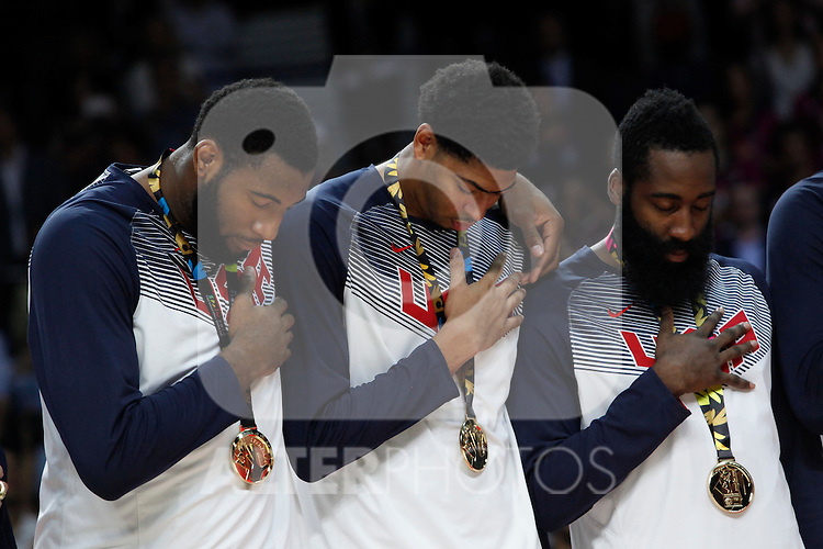 United State´s Harden, Davis and Drummond listen to the national anthem with the golden medal during FIBA Basketball World Cup Spain 2014 final award ceremony after winning against Serbia at `Palacio de los deportes´ stadium in Madrid, Spain. September 14, 2014. (ALTERPHOTOSVictor Blanco)