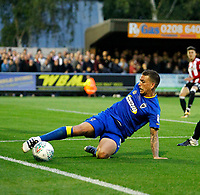 AFC Wimbledon's Cody McDonald keeps the ball in play a during the Carabao Cup match between AFC Wimbledon and Brentford at the Cherry Red Records Stadium, Kingston, England on 8 August 2017. Photo by Carlton Myrie.