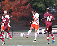 Syracuse University midfielder Nick Perea (8) clears the ball. Boston College (maroon) defeated Syracuse University (white/orange), 3-2, at Newton Campus Field, on October 8, 2013.