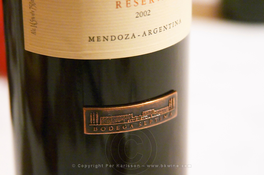 Bottle of Septima Mendoza 2002 Reserva from Codorniu Mendoza, Detail of the bottom metal style label. The Oviedo Restaurant, Buenos Aires Argentina, South America