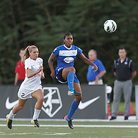 Boston Breakers defender Kia McNeill (14) clears the ball as FC Kansas City substitute forward Melissa Henderson (2) closes. In a National Women's Soccer League (NWSL) match, Boston Breakers (blue) defeated FC Kansas City (white), 1-0, at Dilboy Stadium on August 10, 2013.