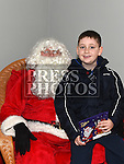 Kyle Boylan who met Santa at the Dunleer Christmas Fair in the Market House. Photo:Colin Bell/pressphotos.ie