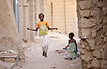 A girl jumps rope in a street in Timbuktu, the northern Mali city that was seized by Islamist fighters in 2012 and then liberated by French and Malian soldiers in early 2013. During the jihadis' rule, girls and women could not appear in public unless they were completely covered.
