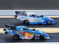 Sep 17, 2016; Concord, NC, USA; NHRA funny car driver John Force (near) races alongside Tommy Johnson Jr during qualifying for the Carolina Nationals at zMax Dragway. Mandatory Credit: Mark J. Rebilas-USA TODAY Sports