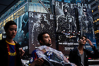 People pass poster of 'Dark Knight Rises' movie premier after NYPD increased security at movie theaters in New York, July 20, 2012.  Photo by Eduardo Munoz Alvarez / VIEW.