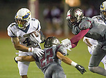 Torrance, CA 09/25/15 - Taz Tauaese (El Segundo #4), Joshua Evans (Torrance #22) and Jerome Duhon (Torrance #1) in action during the El Segundo - Torrance varsity football game at Zamperini Field of Torrance High School