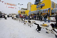 Saturday March 6 , 2010    Dan Seavey runs a sled dog team to celebrate the  Centennial Trail of the Iditarod  during the ceremonial start of the 2010 Iditarod in Anchorage , Alaska