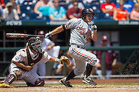 Oregon State outfielder Max Gordon (4) follows through on his swing during Game 11 of the 2013 Men's College World Series against the Mississippi State Bulldogs on June 21, 2013 at TD Ameritrade Park in Omaha, Nebraska. The Bulldogs defeated the Beavers 4-1, to reach the CWS Final and eliminating Oregon State from the tournament. (Andrew Woolley/Four Seam Images)