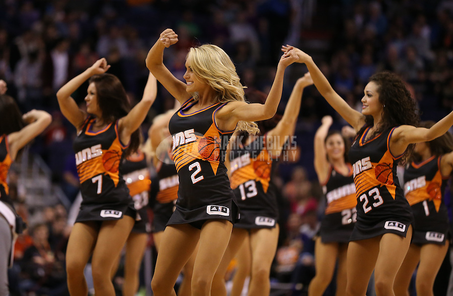 Feb. 10, 2013; Phoenix, AZ, USA: Phoenix Suns dancers perform against the Oklahoma City Thunder at the US Airways Center. Mandatory Credit: Mark J. Rebilas-