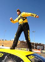 Jul. 18, 2010; Sonoma, CA, USA; NHRA pro stock driver Jeg Coughlin Jr celebrates after winning the Fram Autolite Nationals at Infineon Raceway. Mandatory Credit: Mark J. Rebilas-