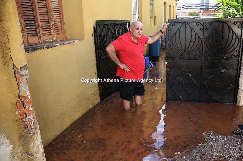 Pictured: A man stands in desperation outside his flooded property in the Magoula area, in the outskirts of Athens, Greece. Wednesday 27 June 2018<br /> Re: Flashflooding has been caused by storm Nefeli in parts of Greece.