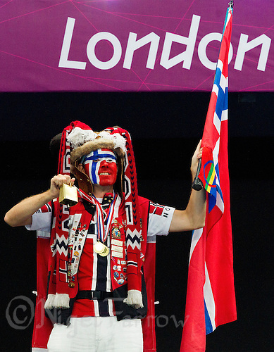 11 AUG 2012 - LONDON, GBR - A Norway supporter cheers his team  after their victory over Montenegro in the women's London 2012 Olympic Games handball final in the Basketball Arena in Olympic Park, in Stratford, London, Great Britain .(PHOTO (C) 2012 NIGEL FARROW)