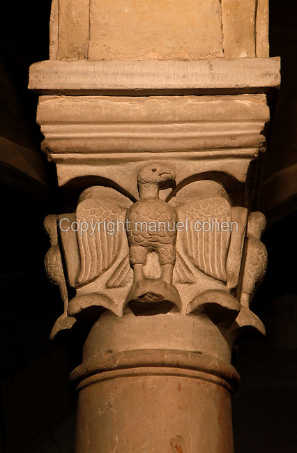 Detail of carved eagle on the capital of a column in the crypt, Basilica di San Zeno, 10th-14th centuries, Verona, Italy. This Romanesque church which forms the pattern for Verona's Romanesque style was constructed in 967 but damaged by an earthquake in 1117 and restored and enlarged from 1138 to 1398. Picture by Manuel Cohen.