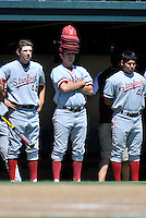 02 June 2008:  Stanford Cardinal players Alex Pracher, Blake Hancock (27, with hats), and student manager Rey Saldana (41) during Stanford's 9-7 win over the Pepperdine Waves in the NCAA Stanford Regional final game at Klein Field at Sunken Diamond in Stanford, CA.