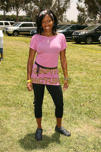 """REGINA KING.""""A Time For Heroes"""" Sponsored by Disney to Benefit the Elizabeth Glaser Pediatric AIDS Foundation held at Wadsworth Theater, Westwood, California, USA,.10 June 2007..full length pink top t-shirt black leggings.CAP/ADM/RE.©Russ Elliot/AdMedia/Capital Pictures."""