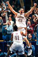 Mark Madsen celebrates a dunk following an Art Lee steal against Rhode Island in the 1998 Midwest Regional Finals. Madsen was fouled, and he made a free throw to give Stanford a 76-74 lead. Stanford won the game 79-77 to advance to the Final Four.