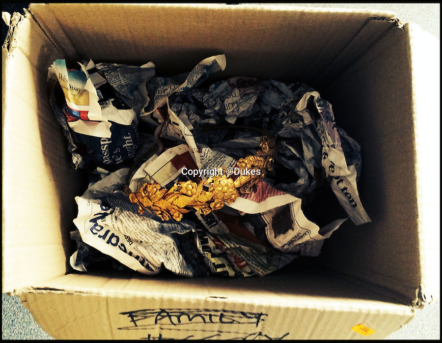 BNPS.co.uk (01202 558833)<br /> Pic: Dukes/BNPS<br /> <br /> The wreath was stored wrapped in newspaper in an old cardboard box. <br /> <br /> Ancient Greek gold wreath discovered - In rural Somerset.<br /> <br /> An incredibly rare gold crown, believed to be more than 2,000 years old, has been discovered in the unlikely surroundings of a modest cottage in Somerset.<br /> <br /> The delicate solid gold myrtle wreath, which is thought to date from the time of Alexander the Great around 300BC, is expected to make at least a whopping £100,000 when it goes up for auction.<br /> <br /> The antiquity was retrieved from a tatty cardboard box kept under the owner's bed and he had no idea just how valuable it might be.<br /> <br /> The wreath will be sold by Duke's of Dorchester on June 9.