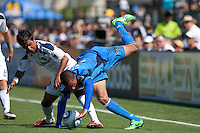Los Angeles Galaxy defender A.J. DeLaGarza (20) battles for the ball against San Jose Earthquakes forward/midfielder Ryan Johnson (19). The San Jose Earthquakes tied the Los Angeles Galaxy 0-0 at Buck Shaw Stadium in Santa Clara, California on June 25th, 2011.
