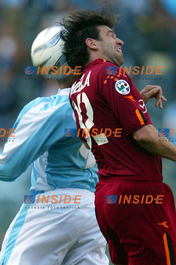 Roma 21/4/2004 Campionato Italiano Serie A <br /> Lazio - Roma 1-1 <br /> Bernardo Corradi (Lazio) and Vincent Candela (Roma)<br /> Lazio and Roma are playing again after it was suspended on March 21, 2004, for security reasons.  <br /> Foto Andrea Staccioli Insidefoto