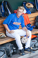 Florida Gators catcher JJ Schwarz (22) sits in the dugout before Game 13 of the NCAA College World Series against the Virginia Cavaliers on June 20, 2015 at TD Ameritrade Park in Omaha, Nebraska. The Cavaliers beat the Gators 5-4. (Andrew Woolley/Four Seam Images)