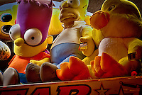 A HDR image from the Arkansas Oklahoma State Fair in Fort Smith, featuring the Simpsons waiting for a luck winner to take them home.