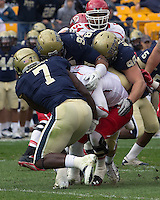 Brandon Lindsey (7), Aaron Donald (97) and Chas Alecxih (98) sack Utah quarterback Jon Hays.The Utah Utes defeated the Pitt Panthers 26-14 at Heinz Field, Pittsburgh, Pennsylvania on October 15, 2011.