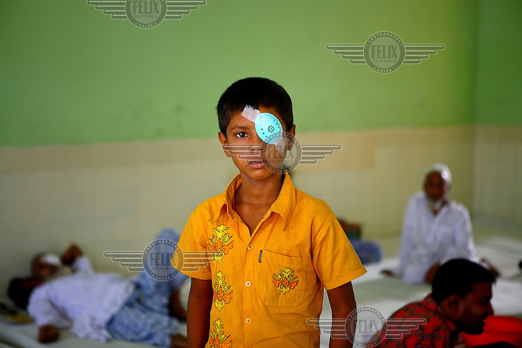 A young boy, wearing an eye protector following a surgical procedure, at the Islamia Eye Hospital. Founded in 1960, about 20,000 eye surgeries are performed in the main hospital annually, that is approximately 10% of the total cataract surgeries in the country.