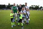 Hibernian and Edinburgh City captains pose for a joint team photo before a pre-season friendly at Meadowbank Stadium. The match was City's first at the Commonwealth Stadium since they gained promotion from the Lowland League to the Scottish League in May 2016. A record crowd for a City match of 2500 spectators saw the visitors run out 6-1 winners.