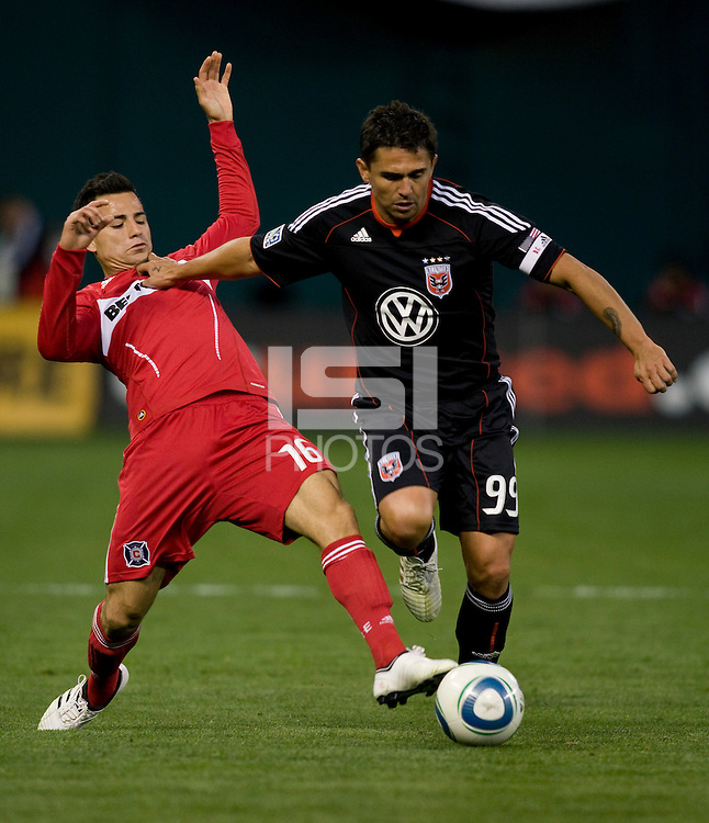 Marco Pappa (16) of the Chicago Fire is held of by Jaime Moreno (99) of DC United at RFK Stadium in Washington, DC.  The Chicago Fire defeated DC United, 2-0.