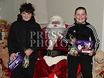 Lorcan Shields and Ryan McShane met Santa at the Christmas fair in the Market house Duneer. Photo:Colin Bell/pressphotos.ie