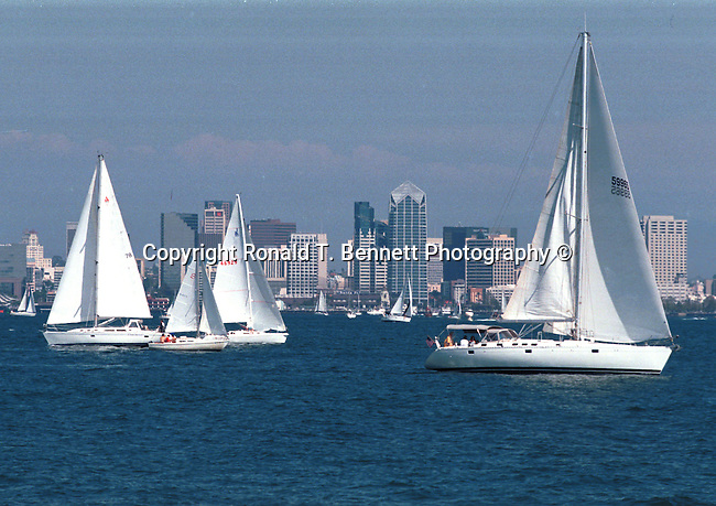 Sail boats on bay with downtown San Diego California,